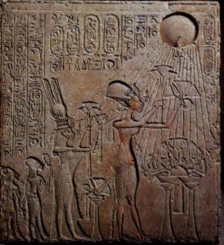 Egyptian Pharaoh worshiping the solar deity Aten